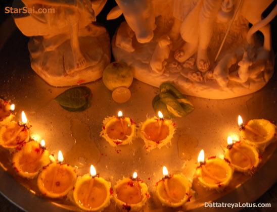 Shirdi Sai baba and Lord Dattatreya in the golden light of lemon lamps